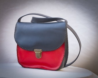 blue/grey and red leather bag