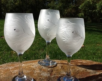 Elegant Frosted peacock feather wine glass with bling..13.95 each individual glass.....handpainted white peacock feather with embellishment.