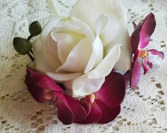 Orchid and rose corsage, purple and ivory corsage, orchid and fern corsage, purple orchid corsage, white rose corsage, white fern corsage