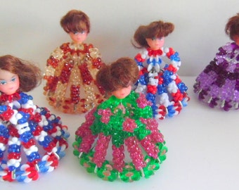 Hand-made, safety pin and beaded doll/ ornament