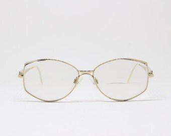 Original 80s stylized vintage glasses. Gold coloured angular frames by Rodier. Clear lens, optical, specs, eyeglasses spectacles