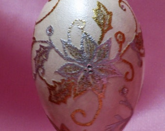 Goose egg adorned with lace and crystals