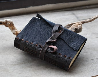Rustic hand sewn leather travel journal
