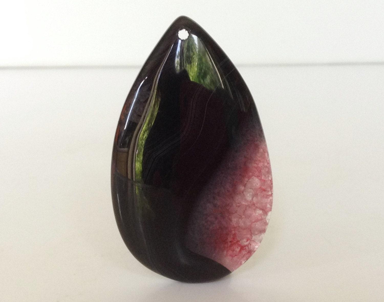 Black teardrop shape