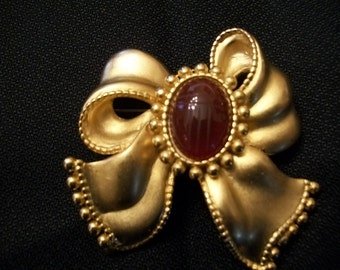 Vintage P.E. P. Goldtone Bow Brooch/Pin with Red Scarab Center