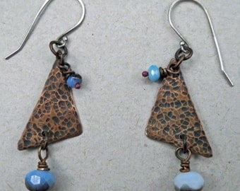 Textured copper earrings with blue Czech glass
