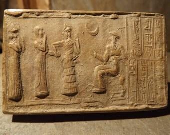 Sumerian cylinder seal of Ur Nammu. Museum replica tablet. Mesopotamian art.