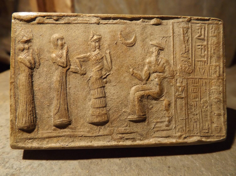 Sumerian cylinder seal of Ur Nammu. Museum replica tablet ...