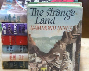 "Hammond Innes   ""The Strange land ""  The Book Club, London 1955"