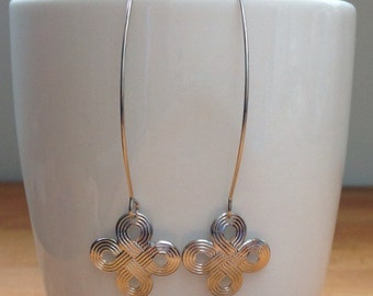 Glossy silver cross pattern earrings
