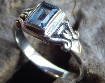 Silver ring simple with blue topaz