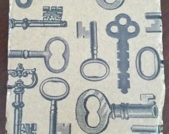 Brown Vintage Keys tumbled marble coasters, Set of 4