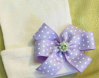 Newborn Hospital Hat. White with Purple Polka Dot Bow topped with Rhinestone.  Perfect New Baby Hospital Hat!
