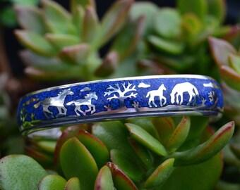 Navajo designed sterling silver & lapis lazuli horse scene storyteller bracelet