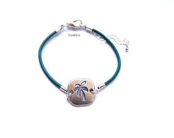 Was blue duck and Palm tree charm leather cord bracelet