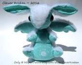 Snow Prince the Angel Bunny, standing winged rabbit, white and teal plush doll
