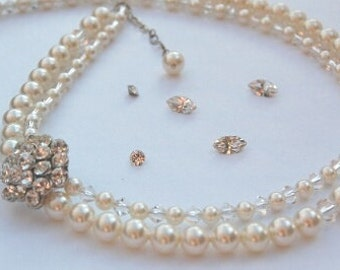 Swarovski crystal and pearl 2-stranded necklace with a Swarovski rhinestone detail.