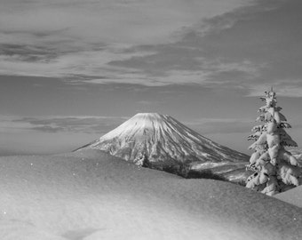 Mt. Yotei in the background and a mound of snow in the foreground