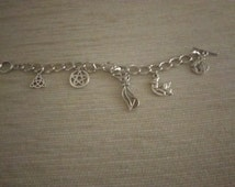Handmade charm braclet silver tone, t- bar fasterner, pentacle,  cat, angel moon, celtic symbol, goddess charms free p&p in the uk