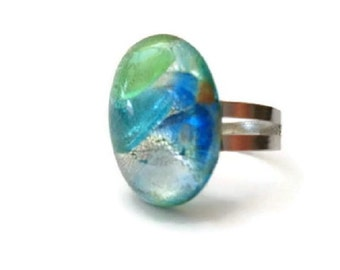 Handcrafted cabochons in back plate, mounted on a metal ring. The base is adjustable and fits all fingers