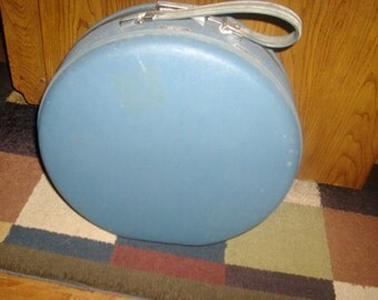 Vintage American Tourister circular suit case