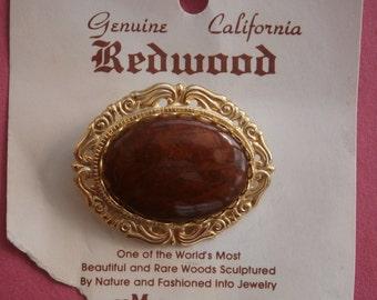 B501) A lovely vintage gold tone metal genuine California redwood brooch