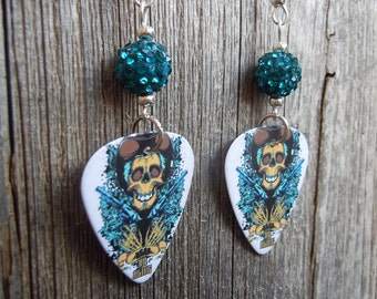 Cowboy Skull with Guns Guitar Pick Earrings with Teal Pave Rhinestone Beads