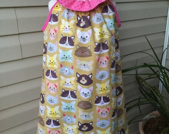 Adorable ruffler dress with cat material