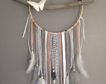 Dream catcher in driftwood, coral, grey and white colour.