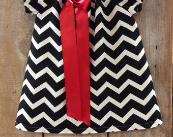 Girls dress in black and white  chevron with red bow-made to order 12 mo to size 6.