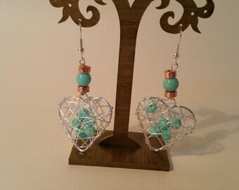 Blue wire heart earrings.