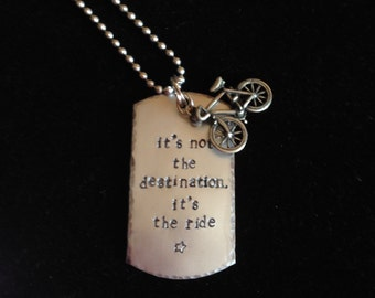 "Hand stamped bicycle pendant  - ""It's not the destination. It's the ride"". Aluminum with pewter bicycle charm."