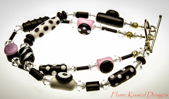 JITTERBUG!....A double strand artisan crafted lampwork glass bead bracelet.