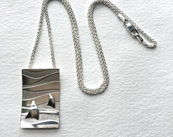 Sterling silver sails necklace