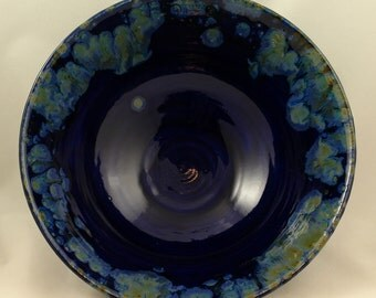 "Large Wheel Thrown Royal Blue Bowl with accents of shades of blue and green. Approx 11.5"" wide x 4.5"" tall. Holds approx 12 cups."