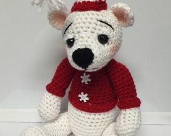 Crocheted Christmas bear snuggle buddy.
