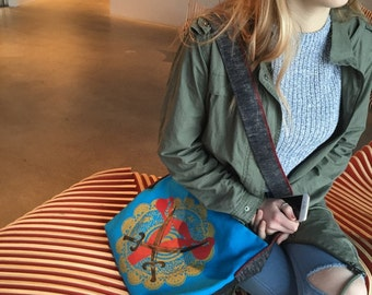 The Woman Warrior Crossbody Bag/ 10 dollars to Planned Parenthood