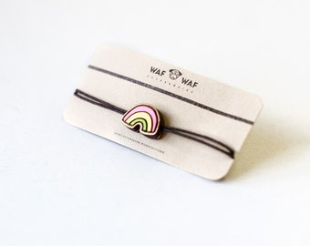 Wooden rainbow bracelet. Cute rainbow bangle, rainbow charm. Wooden bracelet with a small rainbow on it. Rainbow bracelet.
