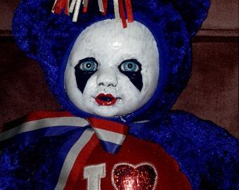 Creepy plush patriotic baby bear doll