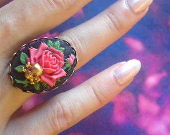 Adjustable ring pink red and little death's head