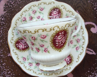 Royal Albert - Cameo Series - Keepsake - Bone China England - Vintage Tea Cup and Saucer - Multiple Pink Roses Cameo