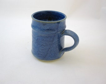 Stoneware mug, wheel-thrown, slip trail decorated, glazed and high fired in gas kiln.