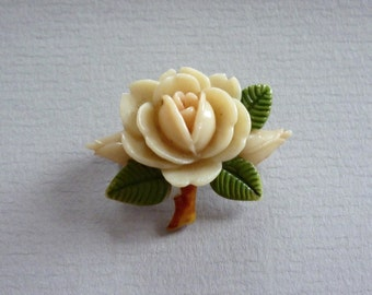 Coming Up Roses, 1950s lucite blossom brooch