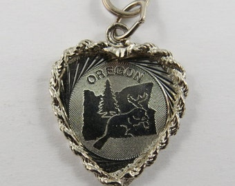 The State of Oregon with Map in the Center within a Heart Shaped Border Sterling Silver Charm or Pendant.