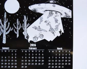 2016 UFO Bicycle Calendar / desert black and white / get weird