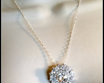 The shine of this Rhinestone Necklace will make certain everyone knows you entered the room.  For a wedding, the LBD, or even Jeans.