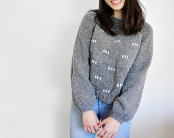 Knitted Grey Jumper Patterned with White Stripes