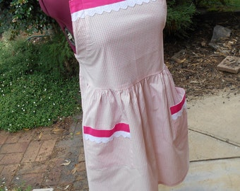 retro style BBQ apron. Pink and white. Adjustable neck strap. Cotton lace trim.