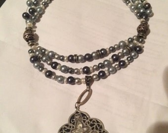 Pearl triple strand necklace with mother of pearl pendant