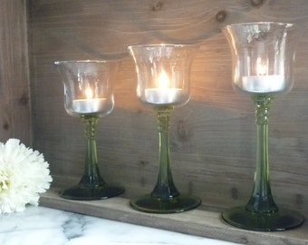 Three Glass Stemmed Candle Holders